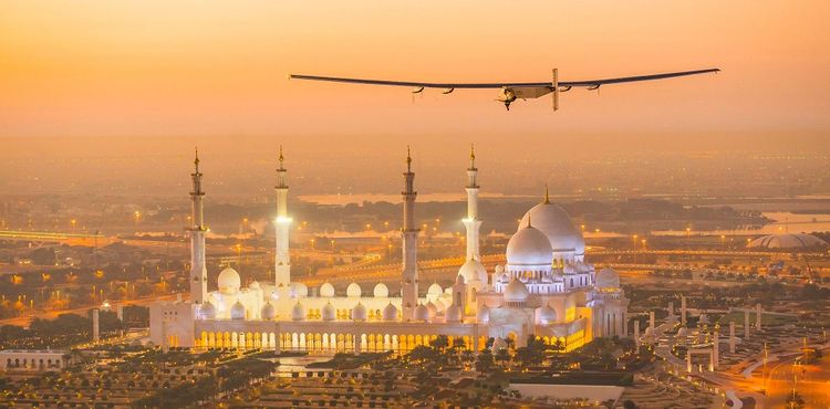 The Solar Impulse 2, a solar-powered plane, flies over the Sheikh Zayed Grand Mosque in Abu Dhabi during preparations for next month's round-the-world flight, February 26, 2015. Swiss pilots Bertrand Piccard and Andre Borschberg will attempt to fly around the world in the Solar Impulse 2, in a bid to prove that such a flight is possible without the use of fossil fuels. The solar-powered plane has a wingspan of 72 metres, larger than that of a Boeing 747, but weighs only 2.3 tons, about as much as a family car. More than 17,000 solar cells on the wing power lithium-ion batteries in four electric motors. The airframe makes use of carbon fiber, which is three times lighter than paper, to keep the plane as light as possible. The 35,000 km flight is expected to take about five months, with stops in Oman, India, Myanmar, China, the United States, and in Southern Europe or North Africa depending on the weather. The Solar Impulse 2 is expected to land back in Abu Dhabi in late July or early August. REUTERS/Solar Impulse/Revillard/Rezo.ch/Handout via Reuters (UNITED ARAB EMIRATES) ATTENTION EDITORS - THIS PICTURE WAS PROVIDED BY A THIRD PARTY. REUTERS IS UNABLE TO INDEPENDENTLY VERIFY THE AUTHENTICITY, CONTENT, LOCATION OR DATE OF THIS IMAGE. NO SALES. NO ARCHIVES. FOR EDITORIAL USE ONLY. NOT FOR SALE FOR MARKETING OR ADVERTISING CAMPAIGNS. THIS PICTURE IS DISTRIBUTED EXACTLY AS RECEIVED BY REUTERS, AS A SERVICE TO CLIENTS